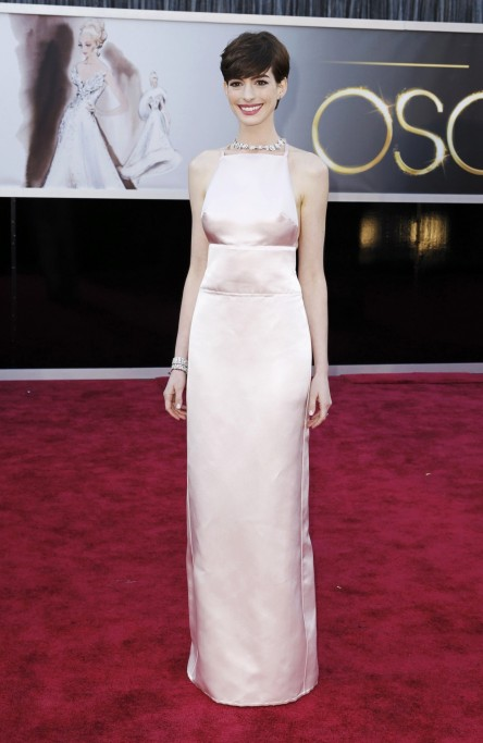 Anne Hathaway Best Supporting Actress Nominee For Her Role In Les Miserables Poses In Prada Light Pink Duchesse Satin Backless Column Gown And Tiffany Diamonds As She Arrives At The Th Academy Body