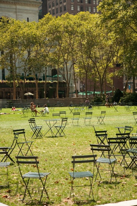 Empty Chairs Scatter On Grass In Sunshine Of Bryant Park Battery Park