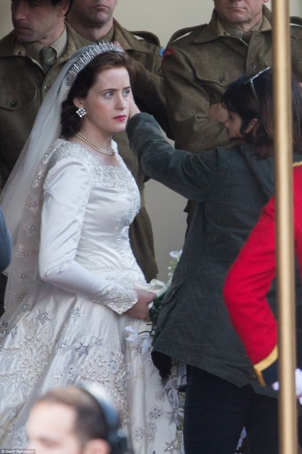 Actress Claire Foyle Has Her Hair Adjusted In Elizabeth Signat Claire Foy