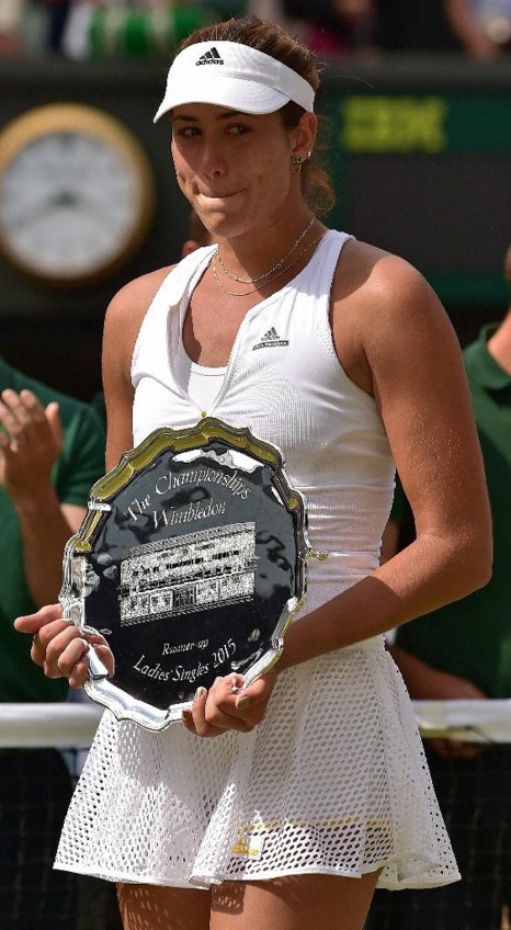 Garbine Muguruza Stands With The Runners Up Shield After