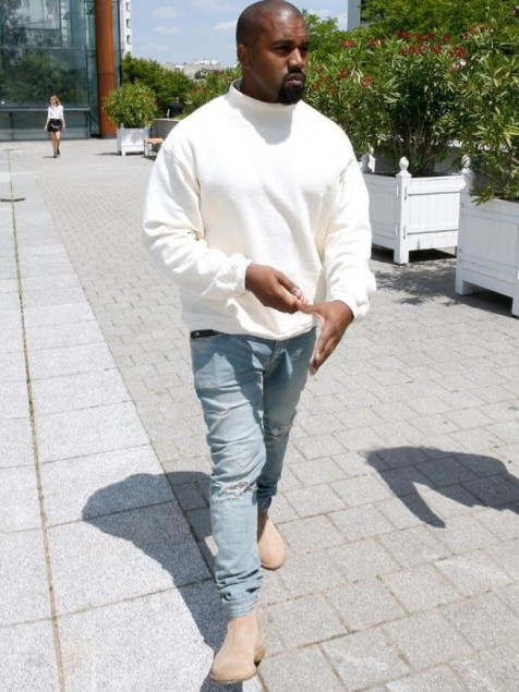 Kanye West Wore Cream Sweater And Distressed Jeans To Attend The Louis Vuitton Mens Spring Show In Paris Kanye West