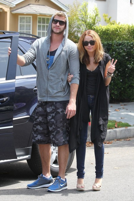 Miley Cyrus And Liam Hemsworth White Dress Black Suit And Miley Cyrus