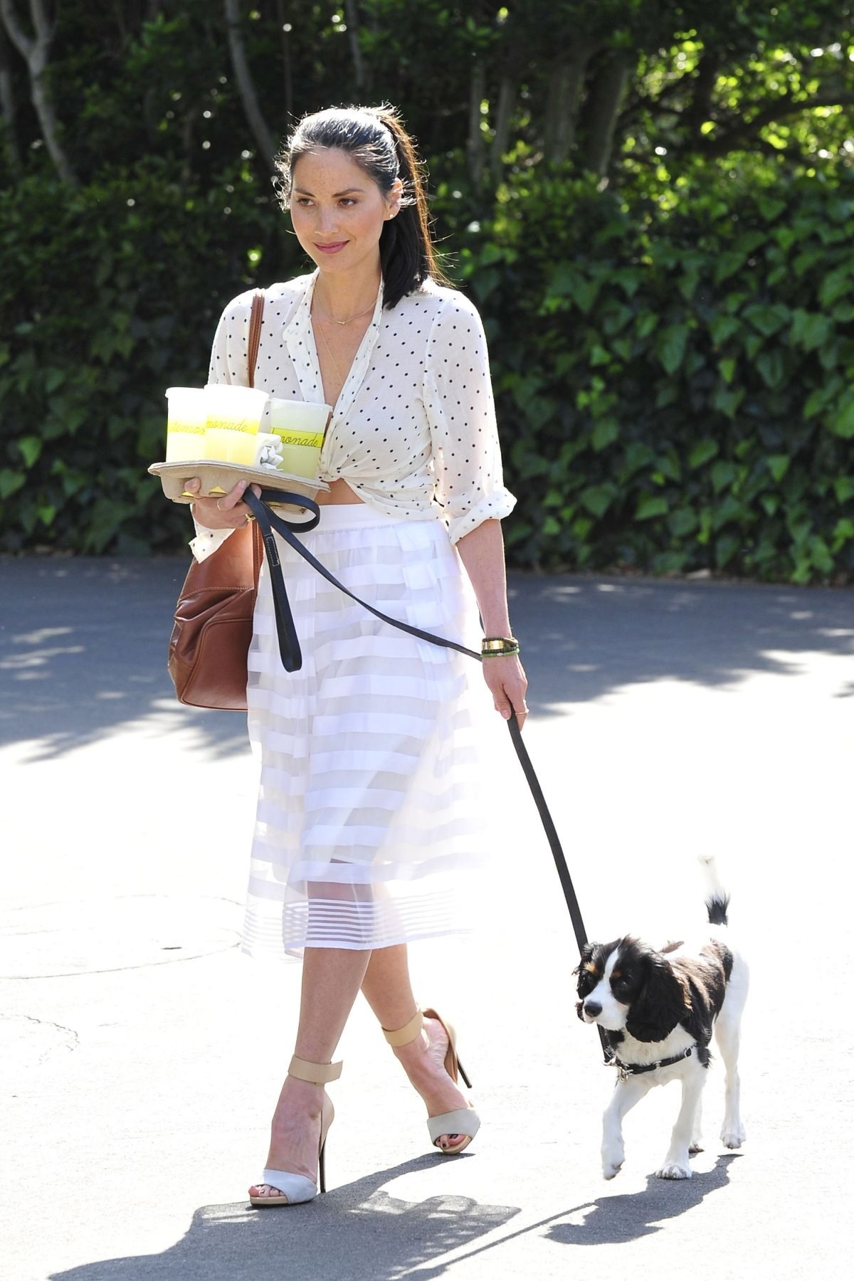 Olivia Munn Carries Three Cups Of Lemonade While Walking Her Dog In Los Angeles