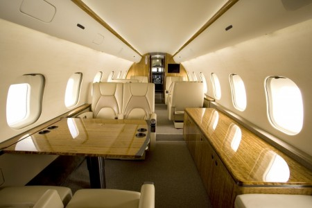 Awesome Private Jet Interior Design Shiny Wooden Furniture And Cozy Brown Seat Private Jets With Bedrooms The Amazing Private Jets With Bedrooms Private Jet