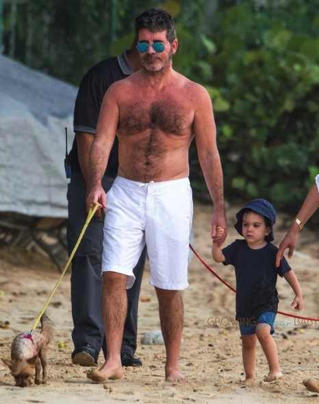 Simon Cowell And Lauren Silverman Stroll On The Beach With Son Eric In Barbados